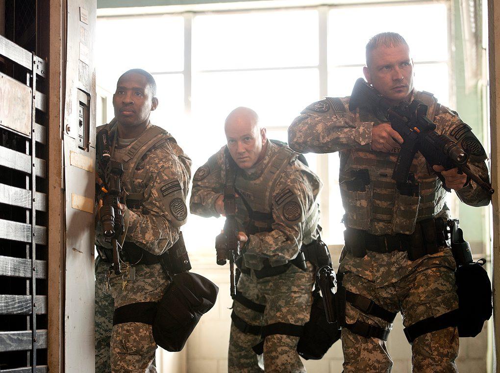 soldiers breaching door