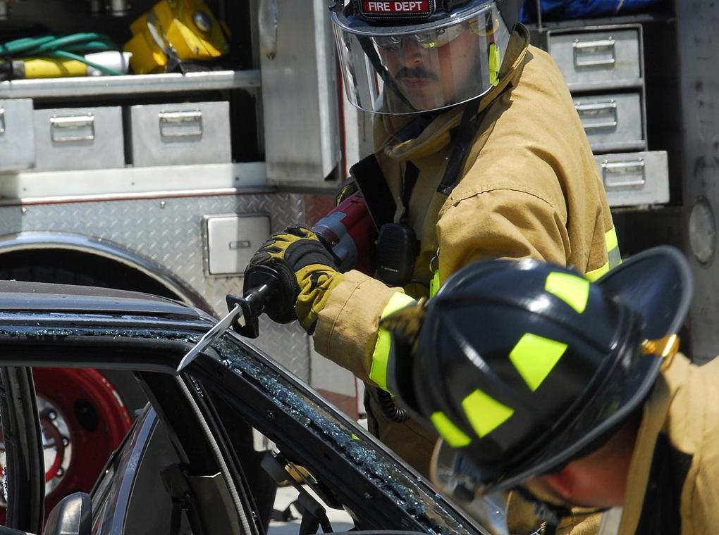 emergency service workers removing vehicle door