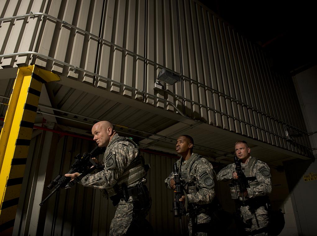 soldiers in dark, industrial setting