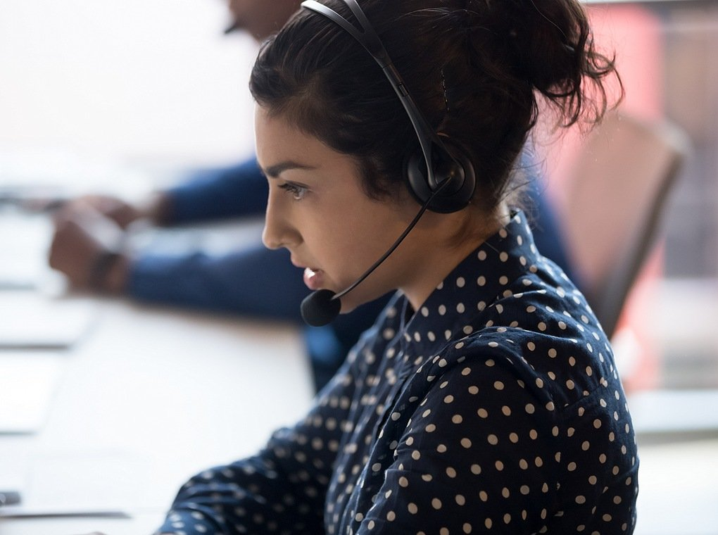 female call center worker wearing microphone headset