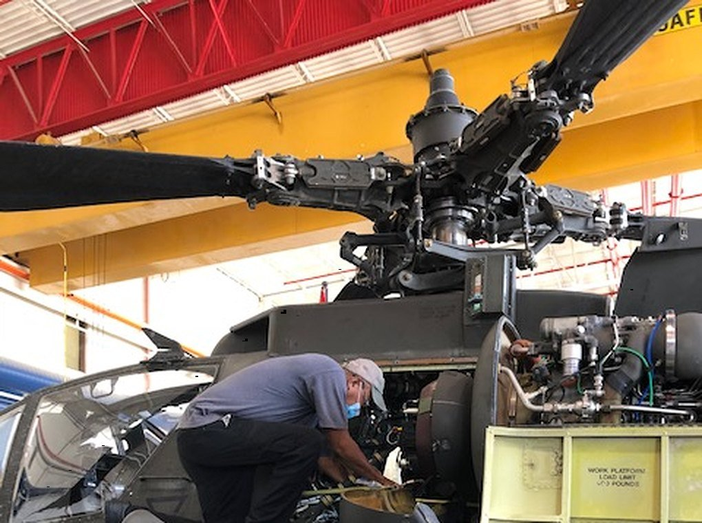 worker repairing military helicopter