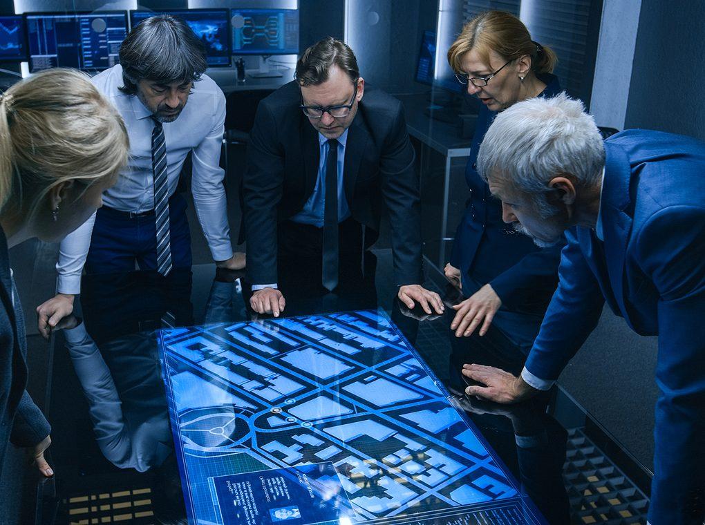 intelligence staff gathered around digital map
