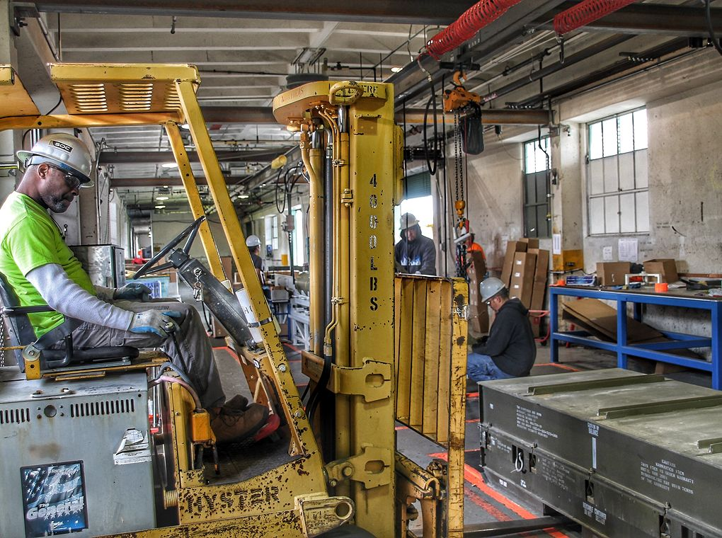 forklift and forklift operator in factory