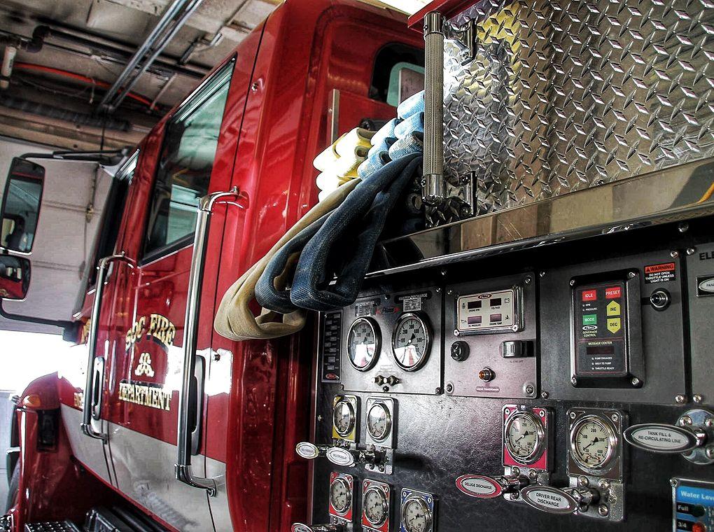 firehoses loaded onto a fire engine