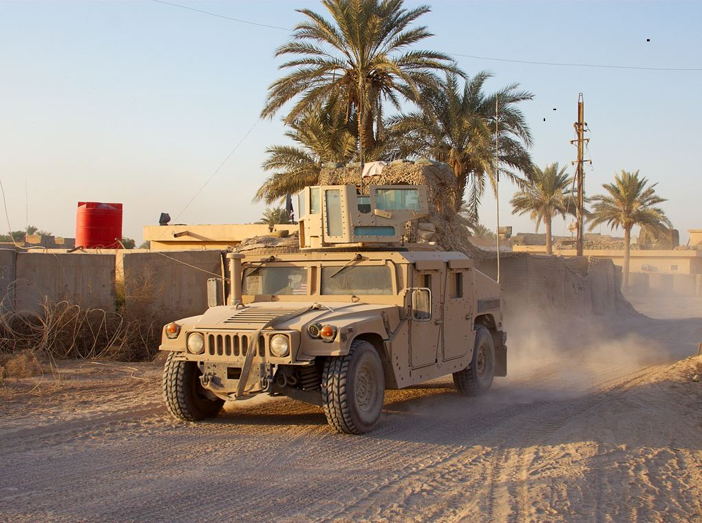 military vehicle in on desert road