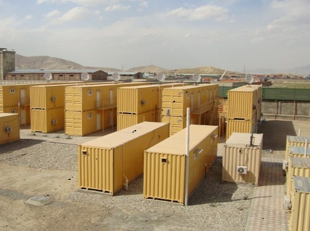yellow, metal cargo containers in an outdoor yard