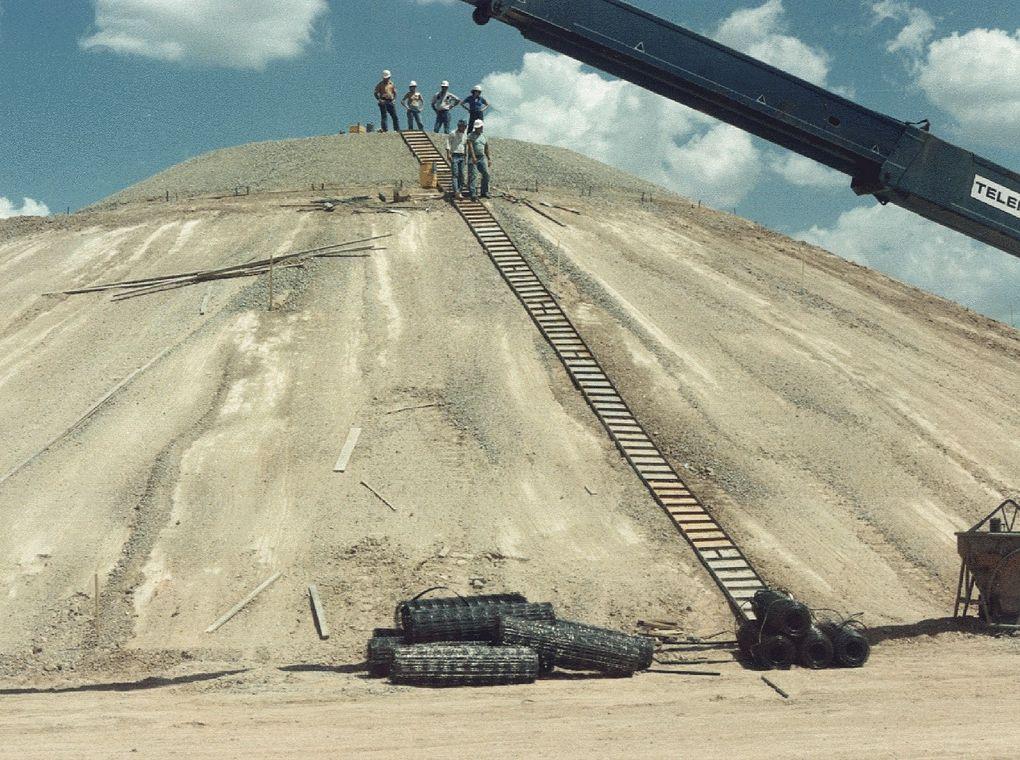 workers on sandy hillside
