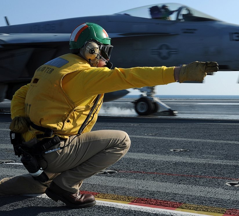 shooter signals F-18 super hornet take off