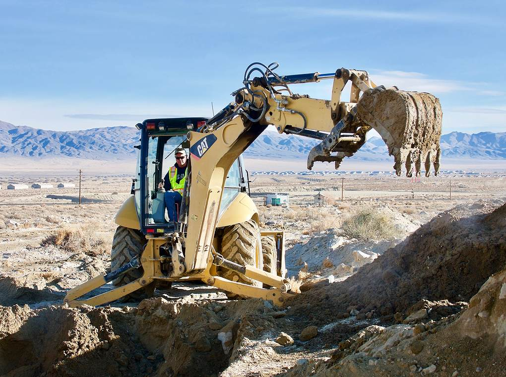 backhoe construction vehicle on rocky terrain