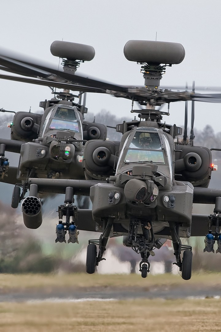 2 apache helicopters in flight